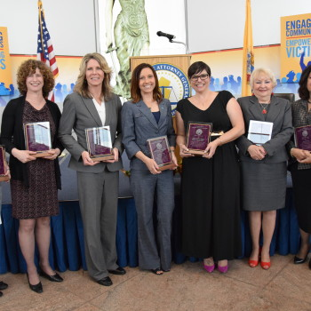 OAG Excellence Awards for Victim's Justice recipients Joan Nixon, Suzanne Groisser, Michele Miller, Patricia Teffenhart, Laura Luciano, Sharon Mai, and Jayne Guarino.
